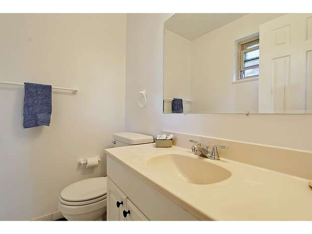Bathroom of 12321 38th Ave. N.E. The 2,540-square-foot home, built in 1960, has four bedrooms, 2.25 bathrooms, an updated kitchen, a family room and a back patio on a 10,446-square-foot lot. It's listed for $475,000. Photo: Tucker English Photography/Courtesy Elaine Shankland/John L. Scott Real Estate