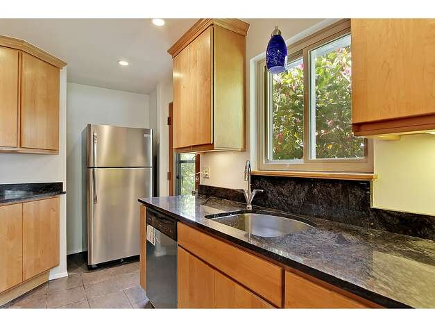 Kitchen of 12321 38th Ave. N.E. The 2,540-square-foot home, built in 1960, has four bedrooms, 2.25 bathrooms, a family room and a back patio on a 10,446-square-foot lot. It's listed for $475,000. Photo: Tucker English Photography/Courtesy Elaine Shankland/John L. Scott Real Estate