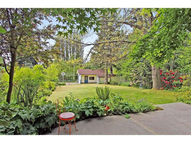 Back yard of 12321 38th Ave. N.E. The 2,540-square-foot home, built in 1960, has four bedrooms, 2.25 bathrooms, an updated kitchen, a family room and a back patio on a 10,446-square-foot lot. It's listed for $475,000. Photo: Tucker English Photography/Courtesy Elaine Shankland/John L. Scott Real Estate