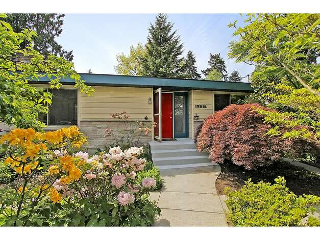 Moving back to 1960, here's 12321 38th Ave. N.E. The 2,540-square-foot home has four bedrooms, 2.25 bathrooms, an updated kitchen, a family room and a back patio on a 10,446-square-foot lot. It's listed for $475,000. Photo: Tucker English Photography/Courtesy Elaine Shankland/John L. Scott Real Estate