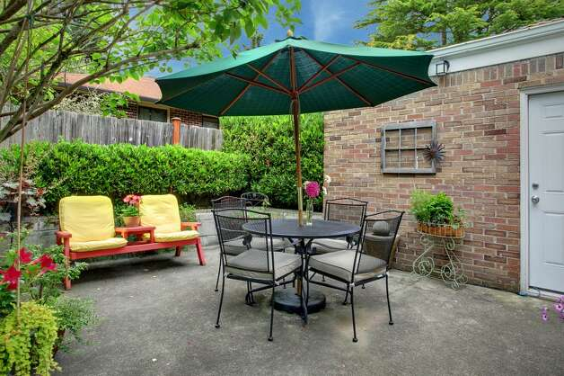 Patio of 2152 N.E. 102nd St. The 2,920-square-foot house, built in 1946, has three bedrooms, 1.75 bathrooms, an updated kitchen, lots of windows, a basement rec room with a bar and fireplace and gardens on a 9,783-square-foot corner lot. It's listed for $485,000. Photo: Courtesy Gary Everist/Windermere Real Estate