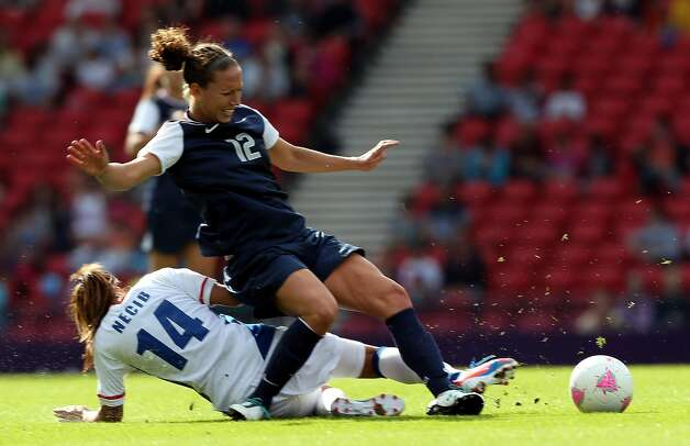 GLASGOW, SCOTLAND - JULY 25:  Lauren Cheney of USA is tackled by Louisa Necib of France during the Women's Football first round Group G Match of the London 2012 Olympic Games between United States and France, at Hampden Park on July 25, 2012 in Glasgow, Scotland.  (Photo by Stanley Chou/Getty Images) (Stanley Chou / Getty Images)