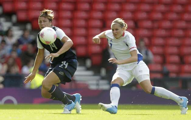 France's Corine Franco (R) challenges USA's Abby Wambach (L) during a group G, Olympic Women's football match at Hampden Park, Glasgow, Scotland, on July 25, 2012.  AFP PHOTO/GRAHAM STUART        (Photo credit should read GRAHAM STUART/AFP/GettyImages) (AFP/Getty Images)