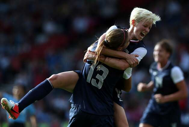 GLASGOW, SCOTLAND - JULY 25:  Alex Morgan #13 of USA is congratulated by Megan Rapinoe after scoring during the Women's Football first round Group G Match of the London 2012 Olympic Games between United States and France, at Hampden Park on July 25, 2012 in Glasgow, Scotland.  (Photo by Stanley Chou/Getty Images) (Stanley Chou / Getty Images)