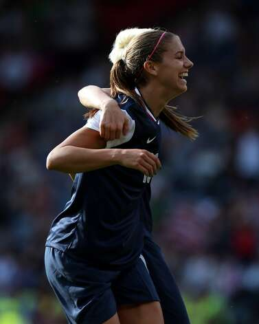 GLASGOW, SCOTLAND - JULY 25: Alex Morgan of USA reacts after scoring during the Women's Football first round Group G Match of the London 2012 Olympic Games between United States and France, at Hampden Park on July 25, 2012 in Glasgow, Scotland.  (Photo by Stanley Chou/Getty Images) (Stanley Chou / Getty Images)