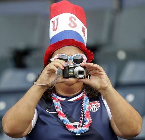 A US supporter takes photographs during a group G, Olympic Women's football match US vs France at Hampden Park, Glasgow, Scotland, on July 25, 2012.  AFP PHOTO/GRAHAM STUART        (Photo credit should read GRAHAM STUART/AFP/GettyImages) (AFP/Getty Images)