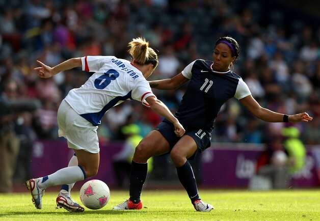 GLASGOW, SCOTLAND - JULY 25: Sydney Leroux of USA chalenges Sonia Bompastor of France during the Women's Football first round Group G Match of the London 2012 Olympic Games between United States and France, at Hampden Park on July 25, 2012 in Glasgow, Scotland.   (Photo by Stanley Chou/Getty Images) (Stanley Chou / Getty Images)