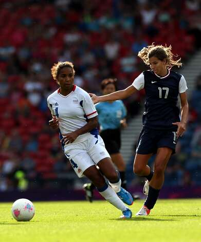 GLASGOW, SCOTLAND - JULY 25: Tobin Heath of USA battles with Laura Georges of France during the Women's Football first round Group G Match of the London 2012 Olympic Games between United States and France, at Hampden Park on July 25, 2012 in Glasgow, Scotland.  (Photo by Stanley Chou/Getty Images) (Stanley Chou / Getty Images)
