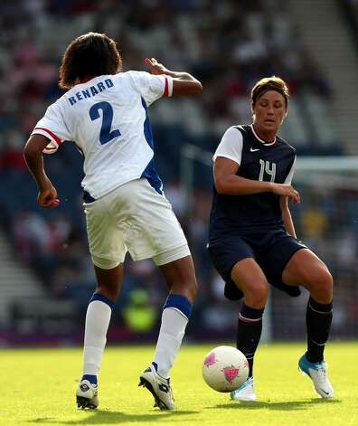 GLASGOW, SCOTLAND - JULY 25:  Abby Wambach of USA challenges Wendie Renard of France during the Women's Football first round Group G Match of the London 2012 Olympic Games between United States and France, at Hampden Park on July 25, 2012 in Glasgow, Scotland.  (Photo by Stanley Chou/Getty Images) (Stanley Chou / Getty Images)