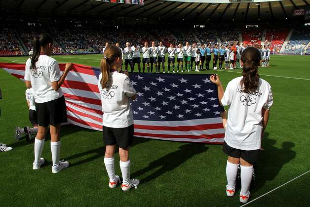 GLASGOW, SCOTLAND - JULY 25:  USA sings their national anthem during the Women's Football first round Group G Match of the London 2012 Olympic Games between United States and France, at Hampden Park on July 25, 2012 in Glasgow, Scotland.  (Photo by Stanley Chou/Getty Images) (Stanley Chou / Getty Images)
