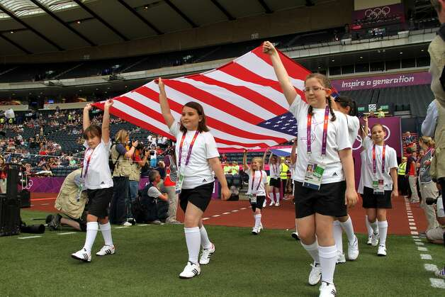 GLASGOW, SCOTLAND - JULY 25: USA flag bearers enter the field during the Women's Football first round Group G Match of the London 2012 Olympic Games between United States and France, at Hampden Park on July 25, 2012 in Glasgow, Scotland.  (Photo by Stanley Chou/Getty Images) (Stanley Chou / Getty Images)