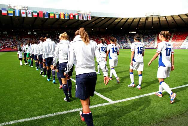 GLASGOW, SCOTLAND - JULY 25:  USA and France enters during the Women's Football first round Group G Match of the London 2012 Olympic Games between United States and France, at Hampden Park on July 25, 2012 in Glasgow, Scotland.  (Photo by Stanley Chou/Getty Images) (Stanley Chou / Getty Images)