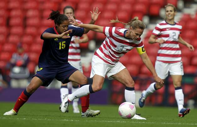 US' Christie Rampone (R) vies with Columbia's Ingrid Vidal during the London 2012 Olympic Games women's football match between Colombia and the USA at Hampden Park, Glasgow, Scotland, on July 28, 2012.  AFP PHOTO/GRAHAM STUART        (Photo credit should read GRAHAM STUART/AFP/GettyImages) (AFP/Getty Images)