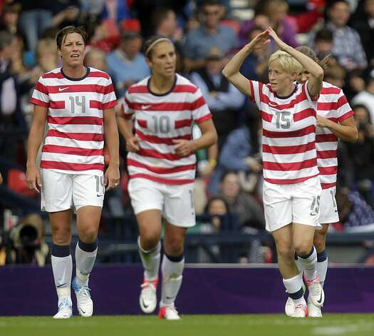 Megan Rapinoe (R) of the US celebrates scoring the first goal against Columbia during the London 2012 Olympic Games women's football match at Hampden Park, Glasgow, Scotland, on July 28, 2012.  AFP PHOTO/GRAHAM STUART        (Photo credit should read GRAHAM STUART/AFP/GettyImages) (AFP/Getty Images)