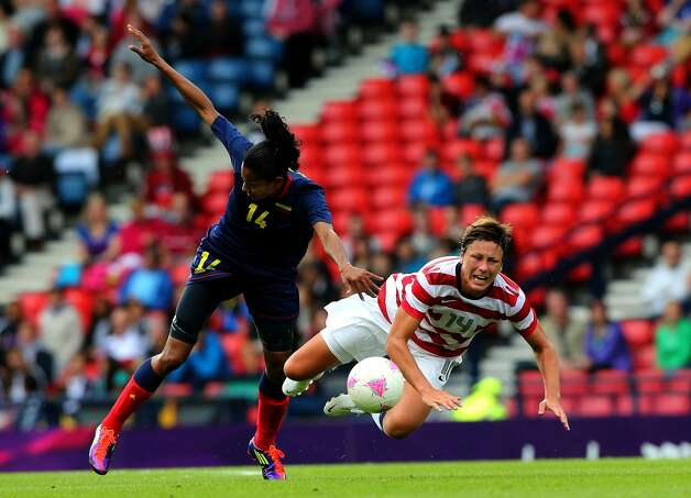 GLASGOW, SCOTLAND - JULY 28: Abby Wambach (R) of USA clashes with Kelis Peduzine of Columbia during the Women's Football first round Group G match between United States and Colombia on Day 1 of the London 2012 Olympic Games at Hampden Park on July 28, 2012 in Glasgow, Scotland.  (Photo by Stanley Chou/Getty Images) (Stanley Chou / Getty Images)