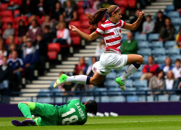 GLASGOW, SCOTLAND - JULY 28: Alex Morgan of USA jumps over Sandra Sepulveda of Columbia during the Women's Football first round Group G match between United States and Colombia on Day 1 of the London 2012 Olympic Games at Hampden Park on July 28, 2012 in Glasgow, Scotland.  (Photo by Stanley Chou/Getty Images) (Stanley Chou / Getty Images)