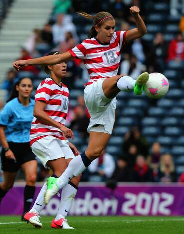 GLASGOW, SCOTLAND - JULY 28: Alex Morgan of USA strikes the ball during the Women's Football first round Group G match between United States and Colombia on Day 1 of the London 2012 Olympic Games at Hampden Park on July 28, 2012 in Glasgow, Scotland.  (Photo by Stanley Chou/Getty Images) (Stanley Chou / Getty Images)