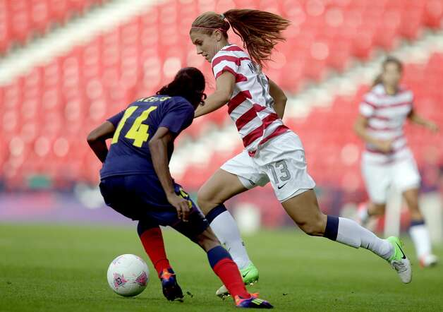 US Alex Morgan (R) vies with Colombia's Kelis Peduzine (L) during their London 2012 Olympic Games women's football match at Hampden Park, in Glasgow, Scotland, on July 28, 2012.  AFP PHOTO/GRAHAM STUART        (Photo credit should read GRAHAM STUART/AFP/GettyImages) (AFP/Getty Images)