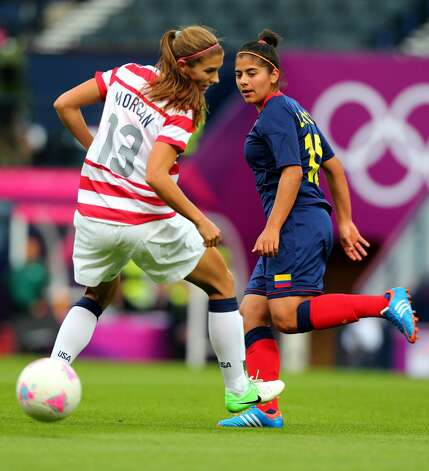 GLASGOW, SCOTLAND - JULY 28:  Alex Morgan of USA back heels the ball during the Women's Football first round Group G match between United States and Colombia on Day 1 of the London 2012 Olympic Games at Hampden Park on July 28, 2012 in Glasgow, Scotland.  (Photo by Stanley Chou/Getty Images) (Stanley Chou / Getty Images)