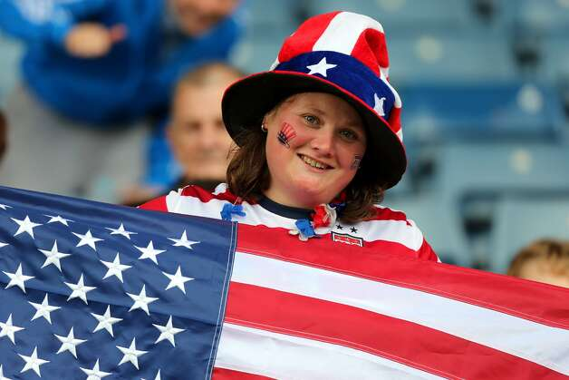 GLASGOW, SCOTLAND - JULY 28:  A USA fan holds an American flag during the Women's Football first round Group G match between United States and Colombia on Day 1 of the London 2012 Olympic Games at Hampden Park on July 28, 2012 in Glasgow, Scotland.  (Photo by Stanley Chou/Getty Images) (Getty Images)
