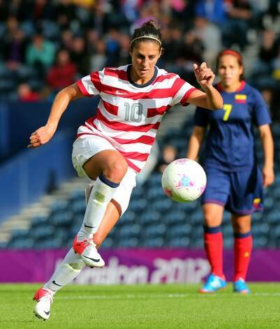 GLASGOW, SCOTLAND - JULY 28:  Carli Llyod of USA kicks during the Women's Football first round Group G match between United States and Colombia on Day 1 of the London 2012 Olympic Games at Hampden Park on July 28, 2012 in Glasgow, Scotland.  (Photo by Stanley Chou/Getty Images) (Getty Images)