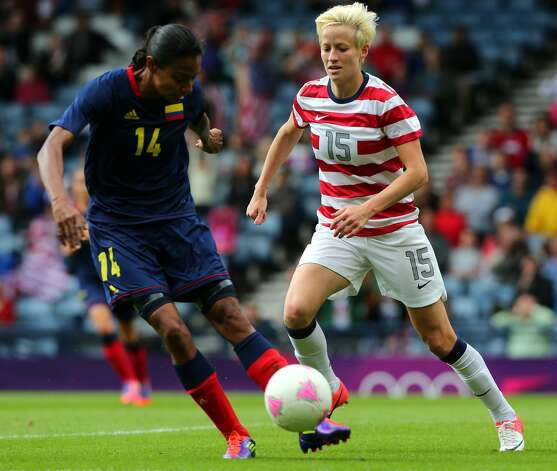 GLASGOW, SCOTLAND - JULY 28:  Megan Rapinoe of USA chases Kelis Peduzine of Columbia during the Women's Football first round Group G match between United States and Colombia on Day 1 of the London 2012 Olympic Games at Hampden Park on July 28, 2012 in Glasgow, Scotland.  (Photo by Stanley Chou/Getty Images) (Getty Images)
