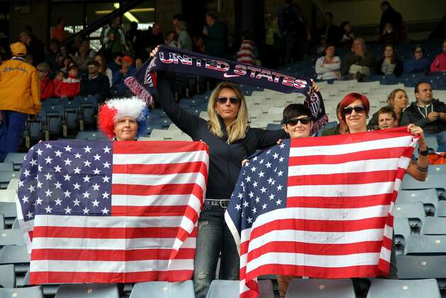 GLASGOW, SCOTLAND - JULY 28:  USA fans hold flags during the Women's Football first round Group G match between United States and Colombia on Day 1 of the London 2012 Olympic Games at Hampden Park on July 28, 2012 in Glasgow, Scotland.  (Photo by Stanley Chou/Getty Images) (Getty Images)