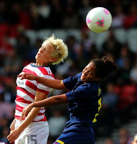 GLASGOW, SCOTLAND - JULY 28:  Megan Rapinoe of USA battles Lady Andrade of Columbia during the Women's Football first round Group G match between United States and Colombia on Day 1 of the London 2012 Olympic Games at Hampden Park on July 28, 2012 in Glasgow, Scotland.  (Photo by Stanley Chou/Getty Images) (Getty Images)