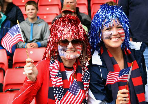 GLASGOW, SCOTLAND - JULY 28:  USA fans smile during the Women's Football first round Group G match between United States and Colombia on Day 1 of the London 2012 Olympic Games at Hampden Park on July 28, 2012 in Glasgow, Scotland.  (Photo by Stanley Chou/Getty Images) (Getty Images)
