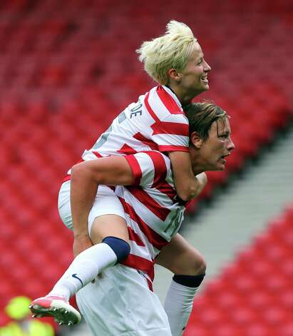 GLASGOW, SCOTLAND - JULY 28:  Abby Wambach of USA celebrates with Megan Ropinoe after scoring against Columbia during the Women's Football first round Group G match between United States and Colombia on Day 1 of the London 2012 Olympic Games at Hampden Park on July 28, 2012 in Glasgow, Scotland.  (Photo by Stanley Chou/Getty Images) Photo: Stanley Chou, Getty Images / 2012 Getty Images