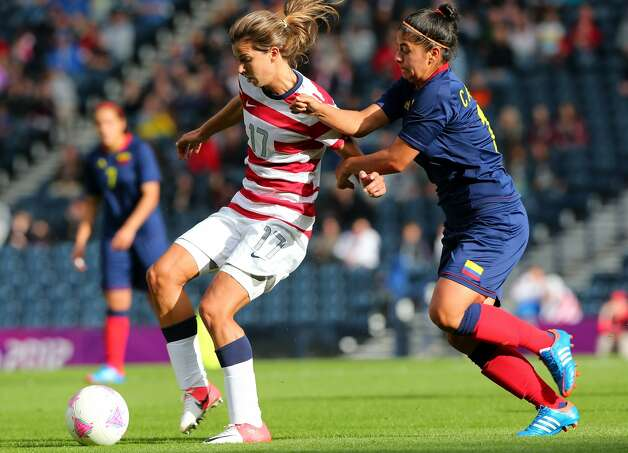 GLASGOW, SCOTLAND - JULY 28: Tobin Heath of USA holds off Abily Camille of Columbia during the Women's Football first round Group G match between United States and Colombia on Day 1 of the London 2012 Olympic Games at Hampden Park on July 28, 2012 in Glasgow, Scotland.  (Photo by Stanley Chou/Getty Images) (Getty Images)