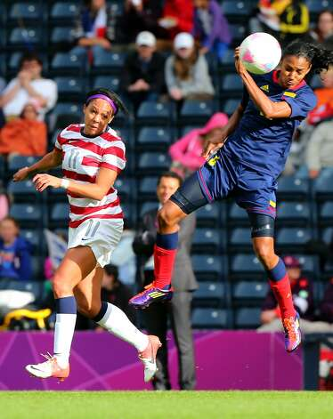 GLASGOW, SCOTLAND - JULY 28: Sydney Leroux of USA battles Sonia Bompastor of Columbia during the Women's Football first round Group G match between United States and Colombia on Day 1 of the London 2012 Olympic Games at Hampden Park on July 28, 2012 in Glasgow, Scotland.  (Photo by Stanley Chou/Getty Images) (Getty Images)