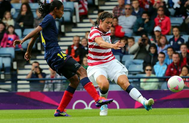 GLASGOW, SCOTLAND - JULY 28: Abby Wambach of USA battles with Louisa Necib of Columbia during the Women's Football first round Group G match between United States and Colombia on Day 1 of the London 2012 Olympic Games at Hampden Park on July 28, 2012 in Glasgow, Scotland.  (Photo by Stanley Chou/Getty Images) (Getty Images)