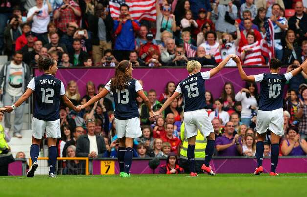 MANCHESTER, ENGLAND - JULY 31:  United States players celebrate the first goal by Abby Wambach during the Women's Football first round Group G match between the United States and DPR Korea,on Day 4 of the London 2012 Olympic Games>> at Old Trafford on July 31, 2012 in Manchester, England.  (Photo by Stanley Chou/Getty Images) (Getty Images)
