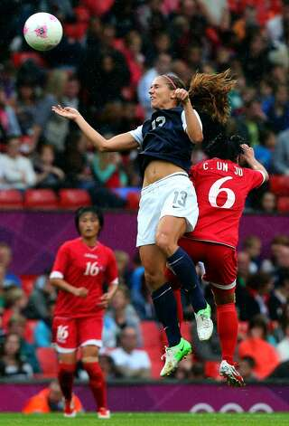 MANCHESTER, ENGLAND - JULY 31:  Alex Morgan of United States clashes with Choe Un Ju of DPR Korea during the Women's Football first round Group G match between the United States and DPR Korea,on Day 4 of the London 2012 Olympic Games at Old Trafford on July 31, 2012 in Manchester, England.  (Photo by Stanley Chou/Getty Images) (Getty Images)