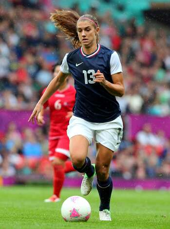 MANCHESTER, ENGLAND - JULY 31:  Alex Morgan of United States runs with the ball during the Women's Football first round Group G match between the United States and DPR Korea,on Day 4 of the London 2012 Olympic Games at Old Trafford on July 31, 2012 in Manchester, England.  (Photo by Stanley Chou/Getty Images) (Getty Images)
