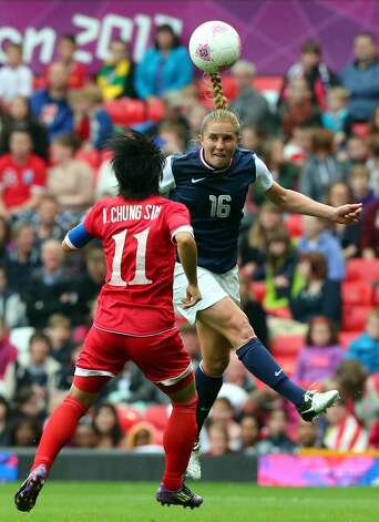 MANCHESTER, ENGLAND - JULY 31: Rachel Buehler of USA is tackled by Kim Chung Sim of DPR Korea during the Women's Football first round Group G match between the United States and DPR Korea,on Day 4 of the London 2012 Olympic Games at Old Trafford on July 31, 2012 in Manchester, England.  (Photo by Stanley Chou/Getty Images) (Getty Images)