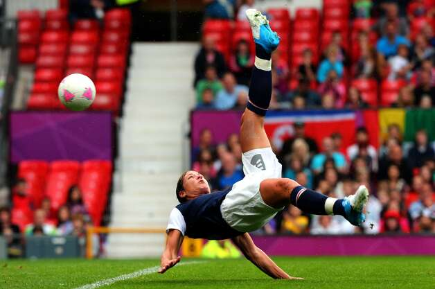 MANCHESTER, ENGLAND - JULY 31:  Abby Wambach of United States executes a bicycle kick the Women's Football first round Group G match between the United States and DPR Korea,on Day 4 of the London 2012 Olympic Games at Old Trafford on July 31, 2012 in Manchester, England.  (Photo by Stanley Chou/Getty Images) (Getty Images)
