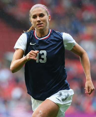 MANCHESTER, ENGLAND - JULY 31:  Alex Morgan of United States runs during the Women's Football first round Group G match between the United States and DPR Korea,on Day 4 of the London 2012 Olympic Games at Old Trafford on July 31, 2012 in Manchester, England.  (Photo by Stanley Chou/Getty Images) (Getty Images)