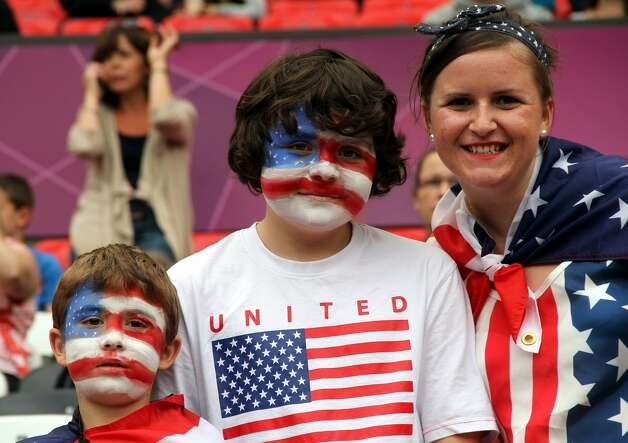 MANCHESTER, ENGLAND - JULY 31:  United States fans enjoy the atmosphere during the Women's Football first round Group G match between the United States and DPR Korea,on Day 4 of the London 2012 Olympic Games at Old Trafford on July 31, 2012 in Manchester, England.  (Photo by Stanley Chou/Getty Images) (Stanley Chou / Getty Images)