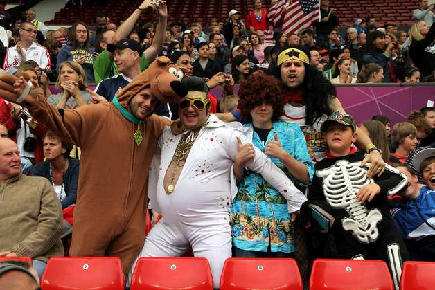 MANCHESTER, ENGLAND - JULY 31:  Football fans in fancy dress enjoy the atmosphere during the Women's Football first round Group G match between the United States and DPR Korea,on Day 4 of the London 2012 Olympic Games at Old Trafford on July 31, 2012 in Manchester, England.  (Photo by Stanley Chou/Getty Images) (Stanley Chou / Getty Images)