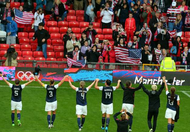 MANCHESTER, ENGLAND - JULY 31:  USA celebrates after they defeated DPR Korea 1-0 during the Women's Football first round Group G match between the United States and DPR Korea,on Day 4 of the London 2012 Olympic Games at Old Trafford on July 31, 2012 in Manchester, England.  (Photo by Stanley Chou/Getty Images) (Stanley Chou / Getty Images)