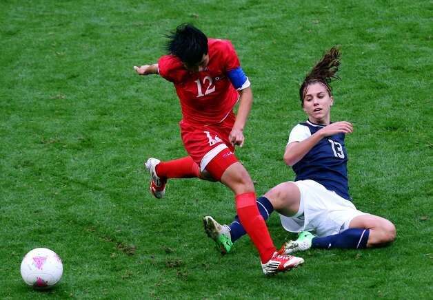 MANCHESTER, ENGLAND - JULY 31: Alex Morgan of USA clashes with Kim Un Hyang of DPR Korea during the Women's Football first round Group G match between the United States and DPR Korea,on Day 4 of the London 2012 Olympic Games at Old Trafford on July 31, 2012 in Manchester, England.  (Photo by Stanley Chou/Getty Images) (Stanley Chou / Getty Images)