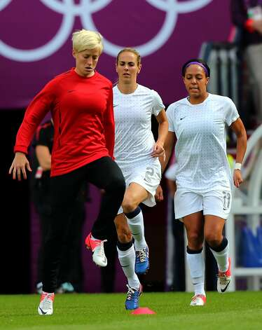 MANCHESTER, ENGLAND - JULY 31:  (L - R) Megan Rapinoe, Heather Mitts and Sydney Leroux of USA warm up the Women's Football first round Group G match between the United States and DPR Korea on Day 4 of the London 2012 Olympic Games at Old Trafford on July 31, 2012 in Manchester, England.  (Photo by Stanley Chou/Getty Images) (Stanley Chou / Getty Images)