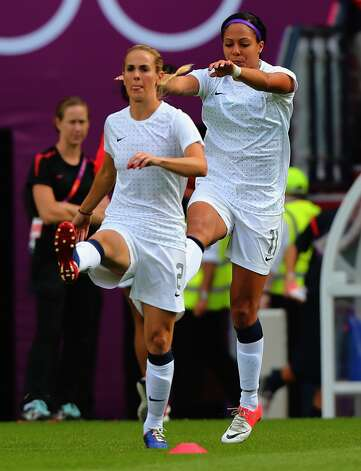 MANCHESTER, ENGLAND - JULY 31:  Heather Mitts and Sydney Leroux of USA warm up the Women's Football first round Group G match between the United States and DPR Korea on Day 4 of the London 2012 Olympic Games at Old Trafford on July 31, 2012 in Manchester, England.  (Photo by Stanley Chou/Getty Images) (Stanley Chou / Getty Images)