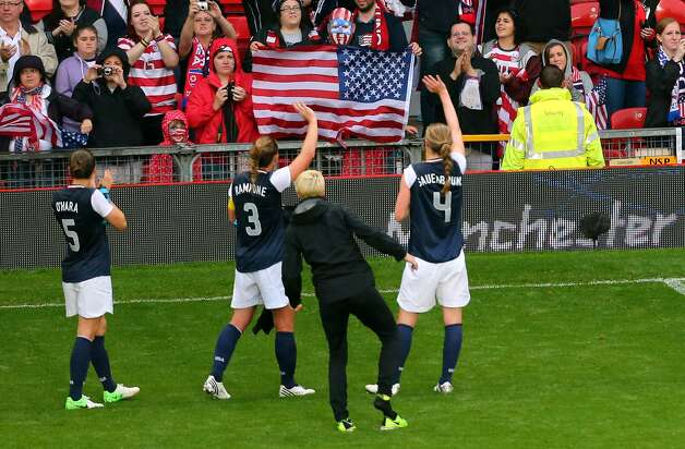 MANCHESTER, ENGLAND - JULY 31:  USA players greet their fans after they defeated DPR Korea 1-0 during the Women's Football first round Group G match between the United States and DPR Korea on Day 4 of the London 2012 Olympic Games at Old Trafford on July 31, 2012 in Manchester, England.  (Photo by Stanley Chou/Getty Images) (Stanley Chou / Getty Images)