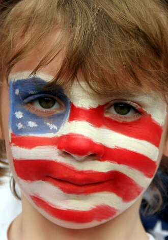 MANCHESTER, ENGLAND - JULY 31:  A USA fan shows support during the Women's Football first round Group G match between the United States and DPR Korea on Day 4 of the London 2012 Olympic Games at Old Trafford on July 31, 2012 in Manchester, England.  (Photo by Stanley Chou/Getty Images) (Stanley Chou / Getty Images)