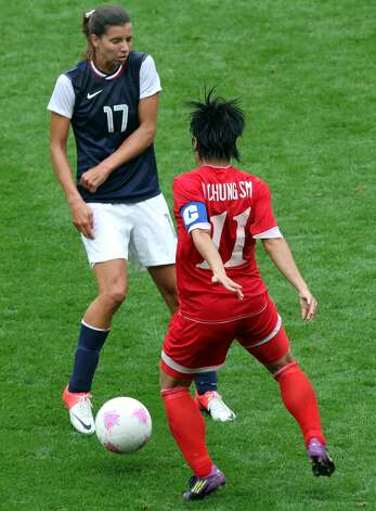 MANCHESTER, ENGLAND - JULY 31: Tobin Heath of USA is tackled by Kim Chung Sim of DPR Korea during the Women's Football first round Group G match between the United States and DPR Korea on Day 4 of the London 2012 Olympic Games at Old Trafford on July 31, 2012 in Manchester, England.  (Photo by Stanley Chou/Getty Images) (Stanley Chou / Getty Images)
