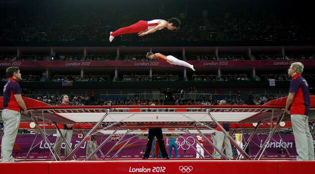 Gymnasts train before the men's trampoline final of the artistic gymnastics event of the London 2012 Olympic Games in London on August 3, 2012. China's Dong Dong won the gold, Russia's Dmitry Ushakov the silver and China's Lu Chunlong bronze. (THOMAS COEX / AFP/Getty Images)