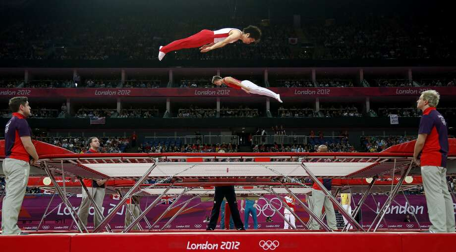 Trampolining made its first appearance at the 2000 Games in Sydney, with men's and women's competitions. Here, gymnasts train before the men's trampoline final of the artistic gymnastics event of the London 2012 Olympic Games. (THOMAS COEX / AFP/Getty Images)